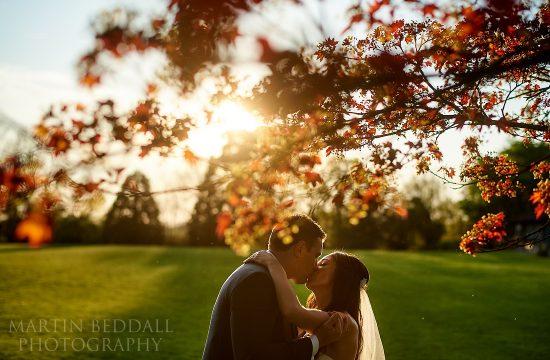 Village hall wedding sunset kiss