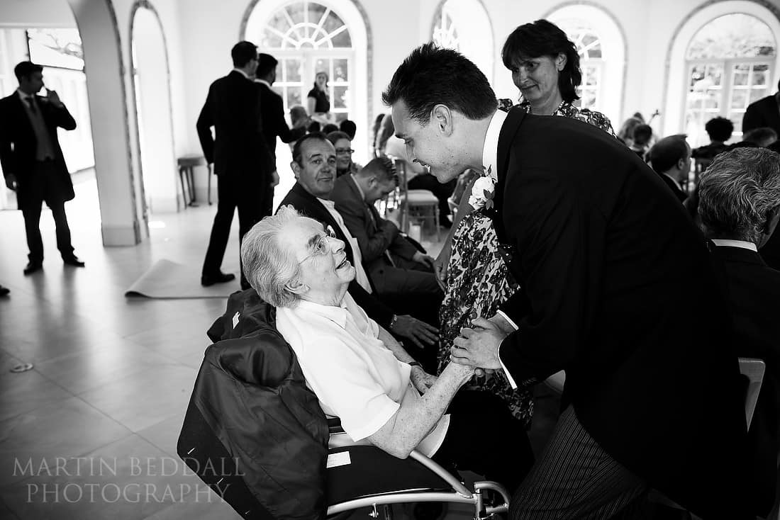 groom greets his grandmother