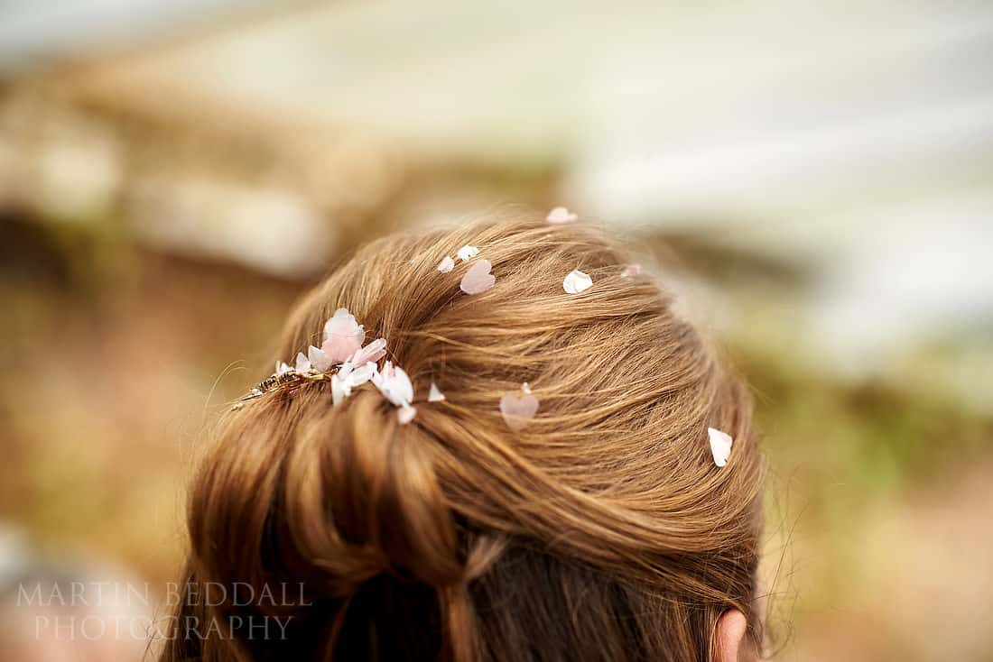 confetti in bride's hair