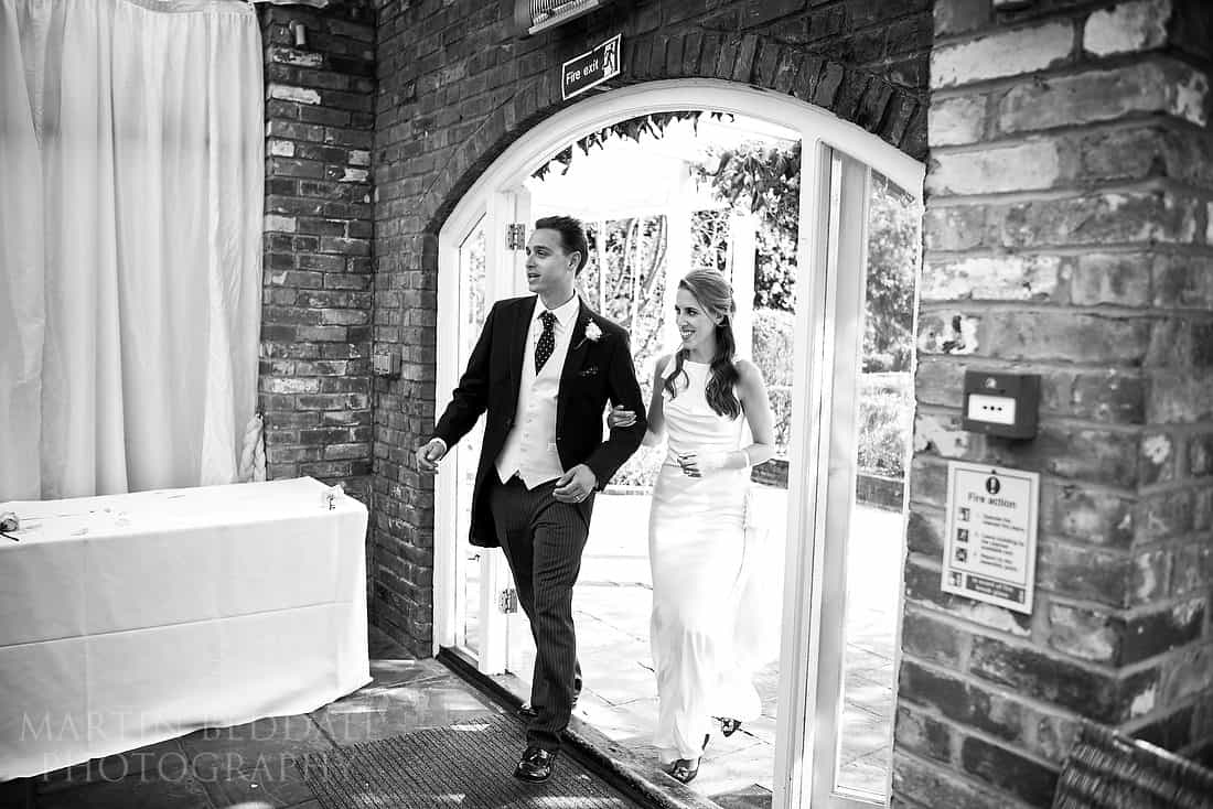 bride and groom enter the orangery
