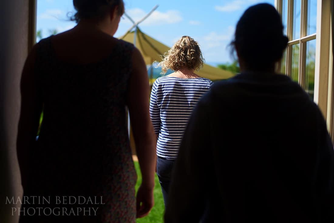 bridesmaids rehearse the ceremony walk