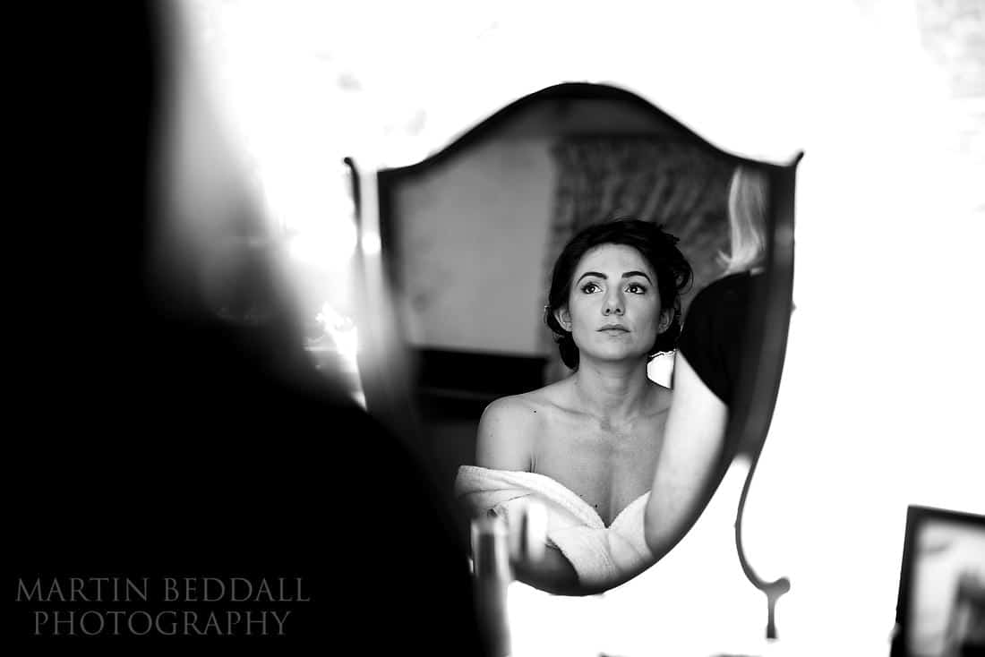 glamourous bride in the mirror