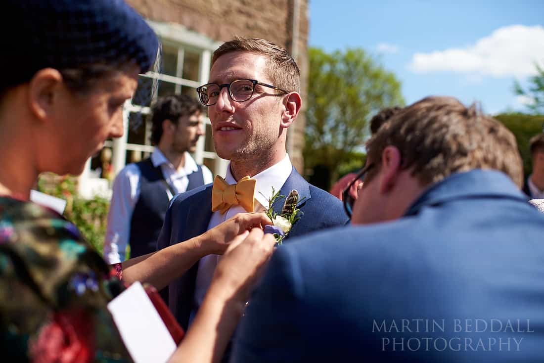 sorting out the groom's flower
