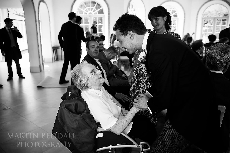 Groom greeting family at Northbrook Park wedding
