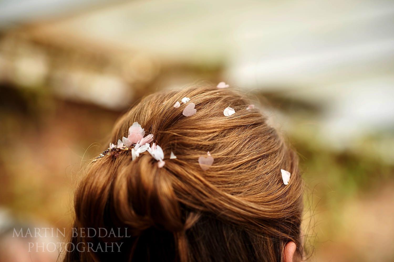 Confetti in the bride's hair