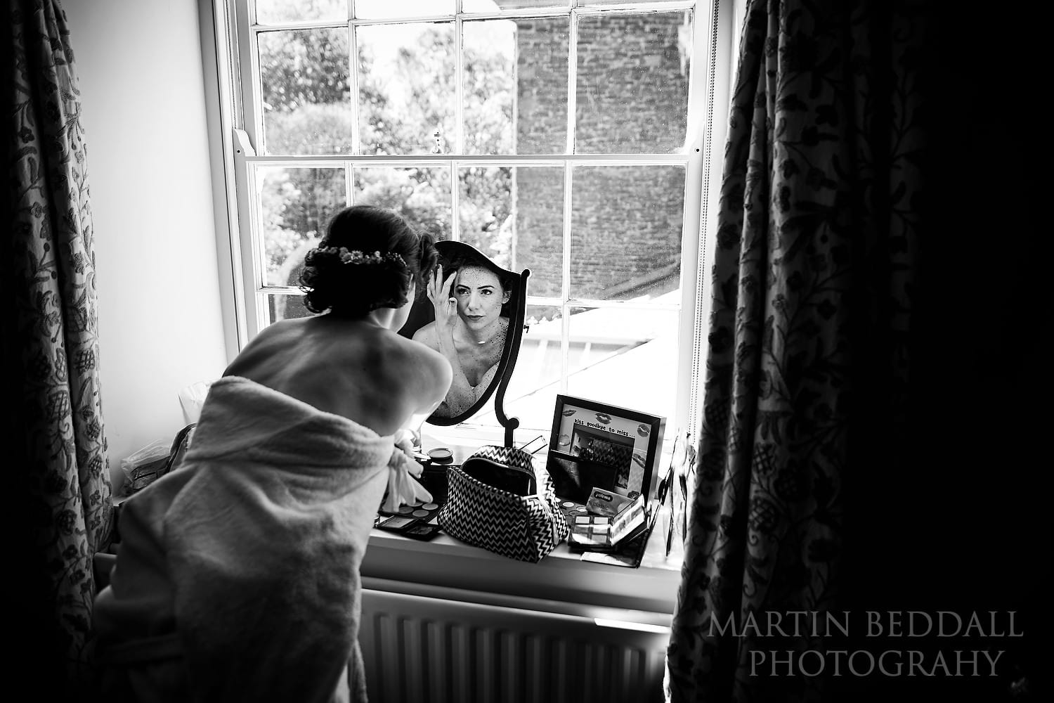 Bride getting ready at Dewsall Court