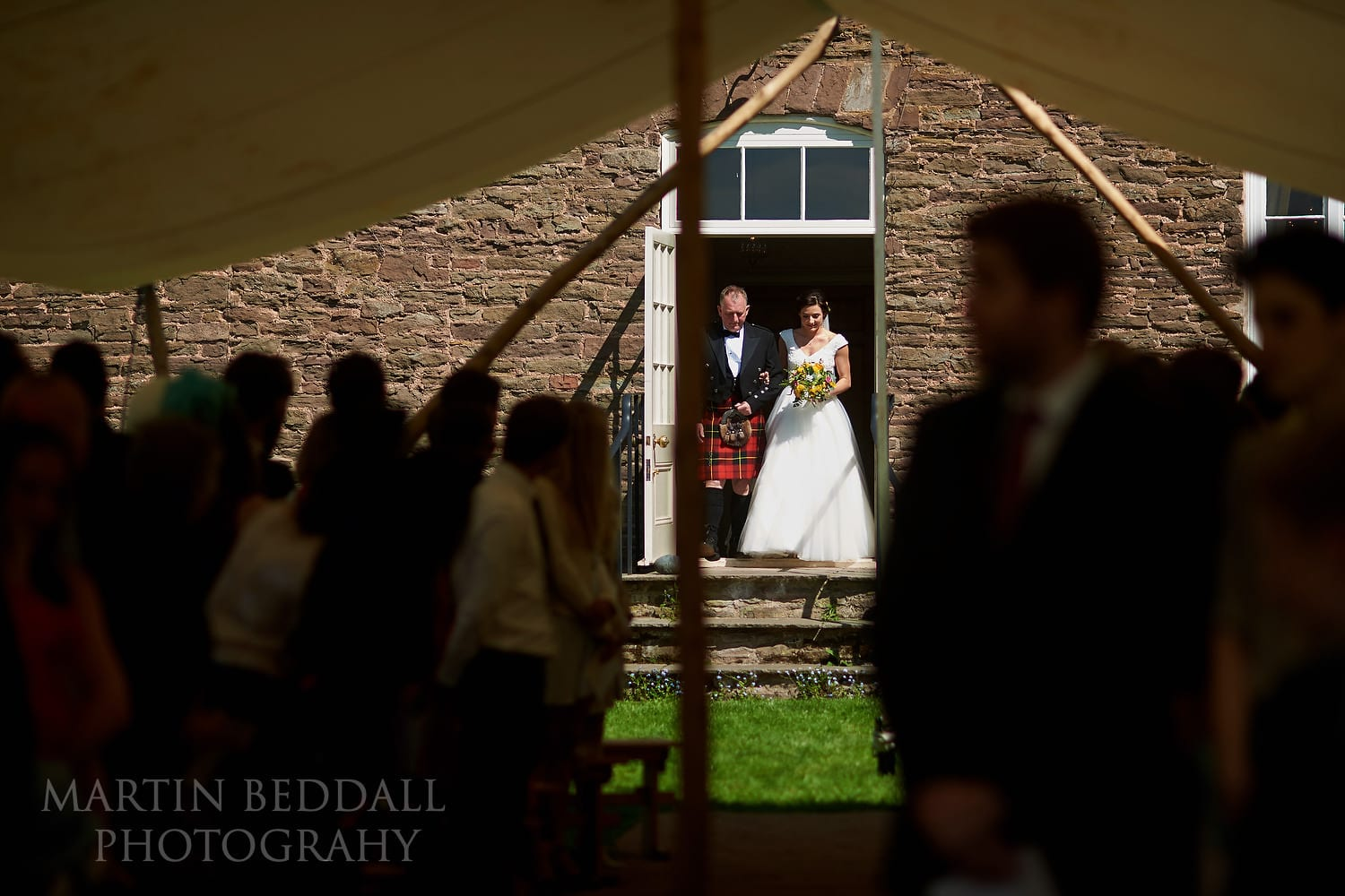 Bride and her father exit Dewsall Court house