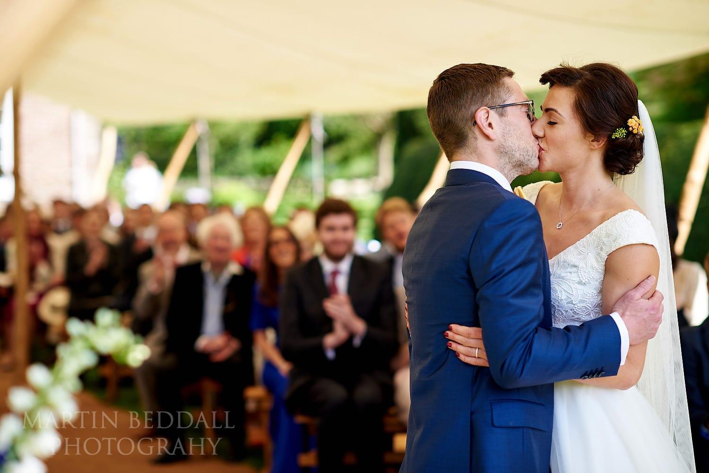 Dewsall Court Wedding ceremony kiss