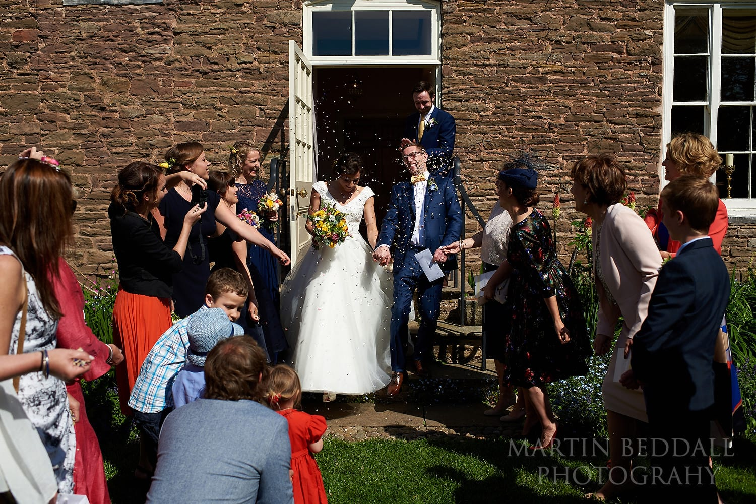 Confetti on the steps at Dewsall Court Wedding