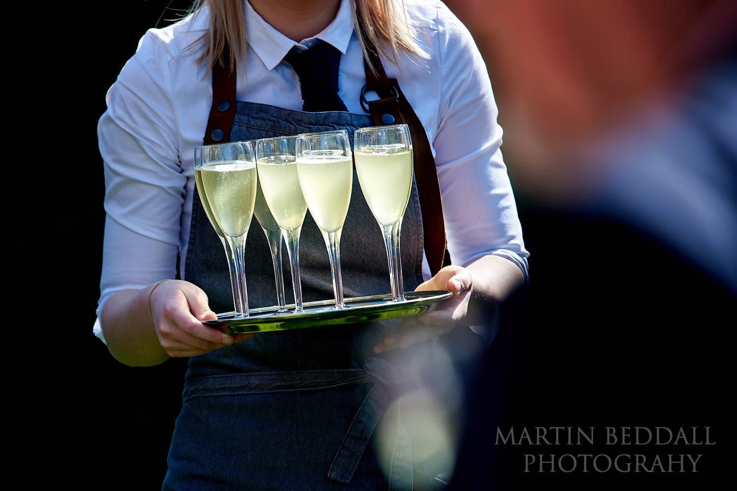 Drinks in the sunsine at Dewsall Court Wedding