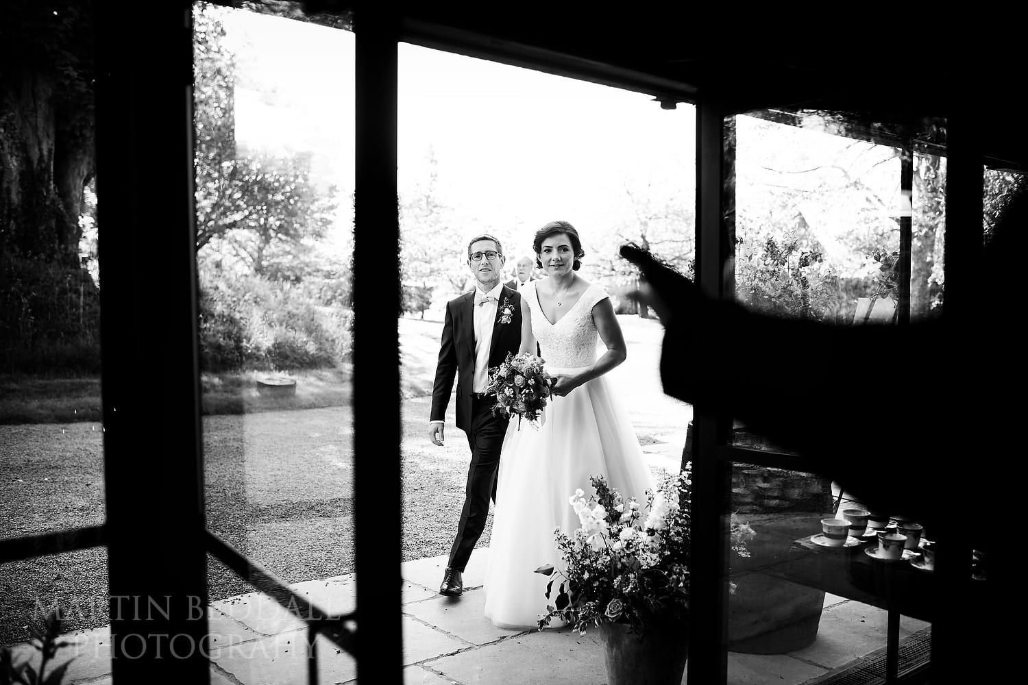 Bride and groom introduced into dinner at Dewsall Court Wedding