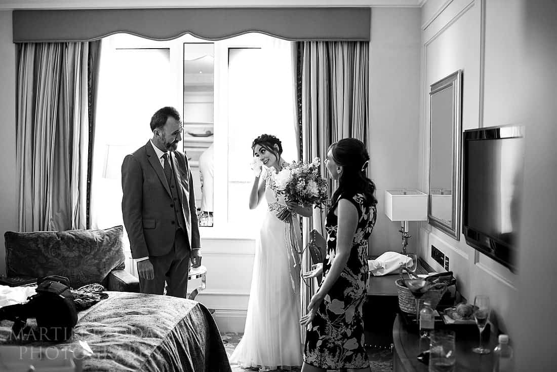 bride tears with mum and dad