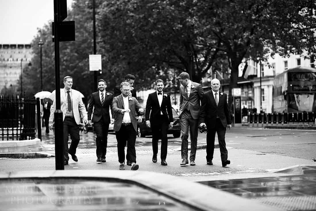 Groom walks to the wedding venue