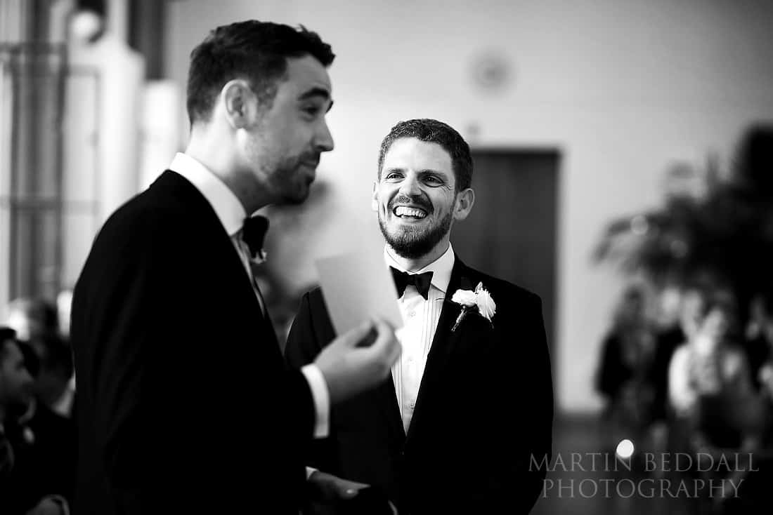 groom laughing with the best man