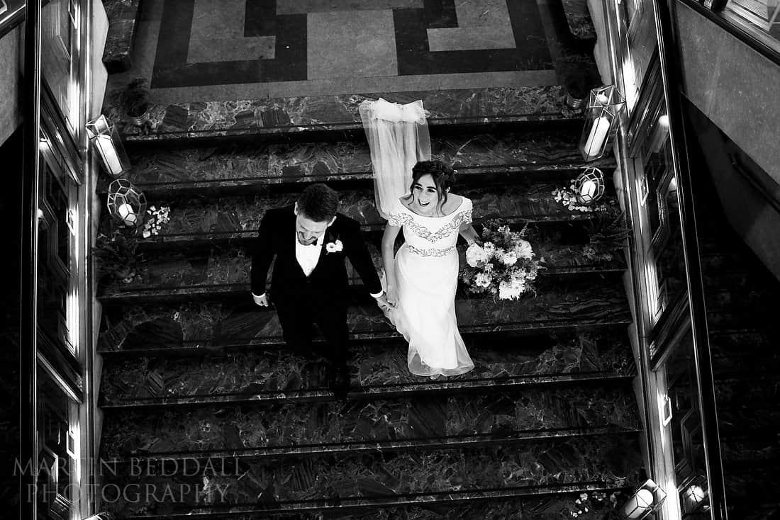 RIBA045Bride and groom on the staircase at RIBA