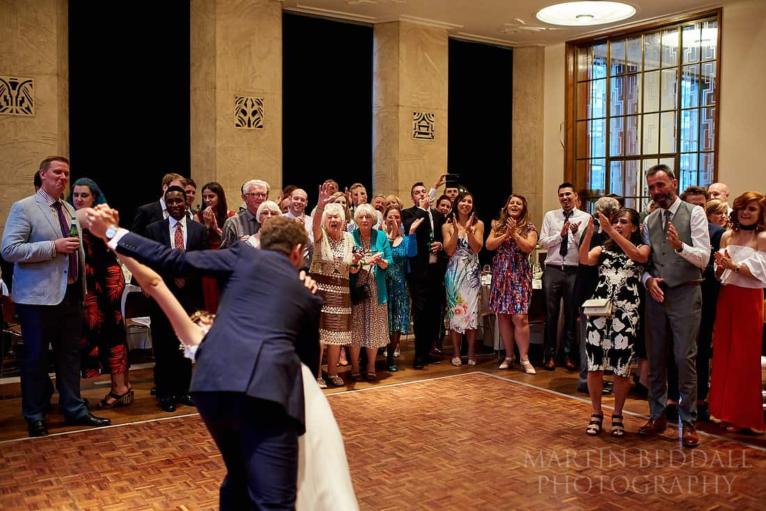 Wedding first dance at RIBA cheering family and friends