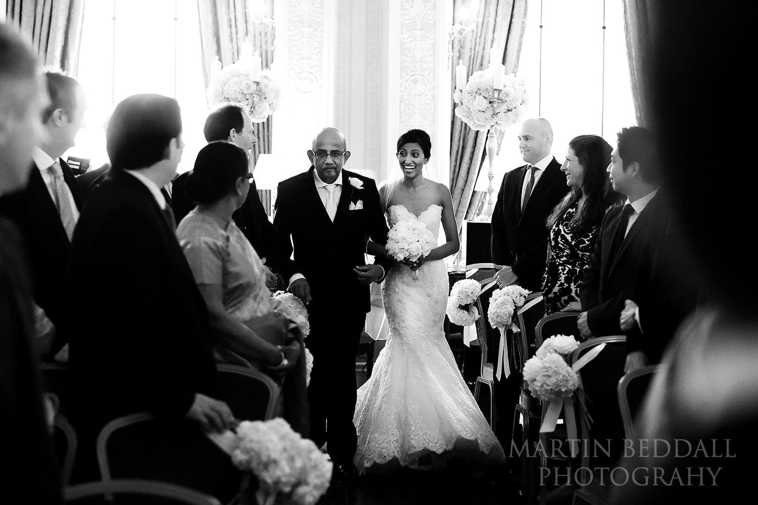Bride and her father enter the ceremony room at the Lansdowne Club