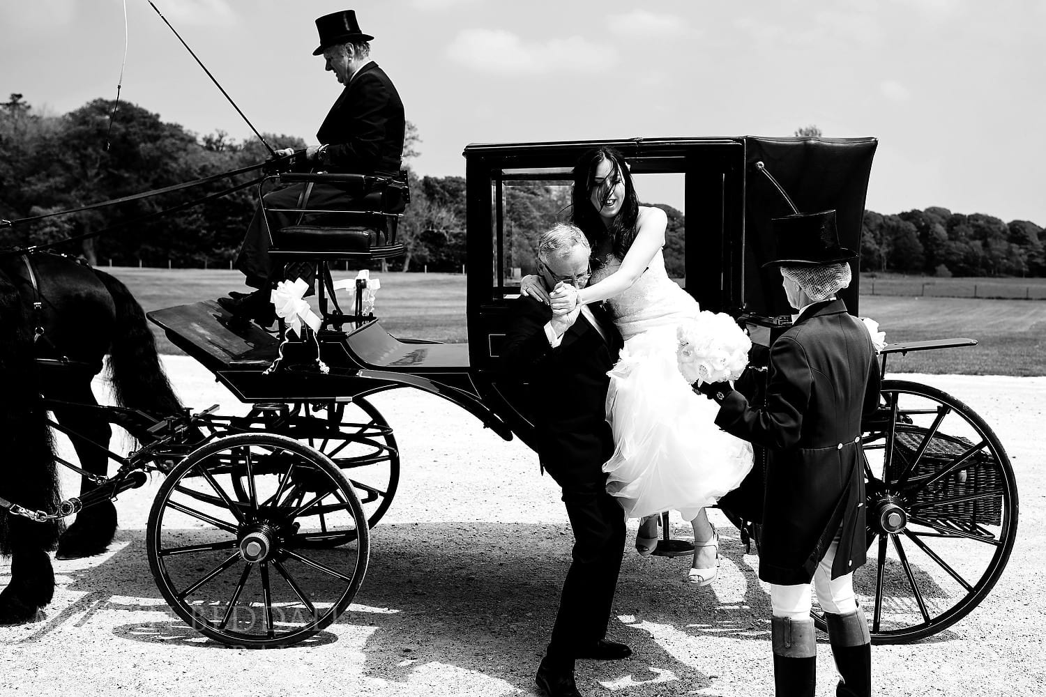Bride helped out of the carriage
