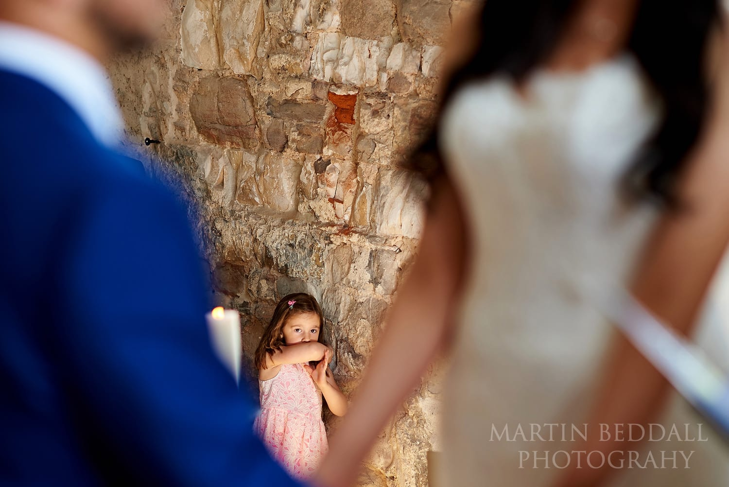 Young guest watching the wedding ceremony