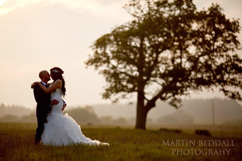 Couple portrait at Lulworth Castle wedding