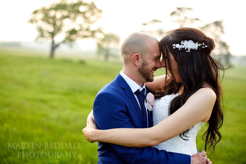 Bride and groom natural portrait at Lulworth Castle wedding