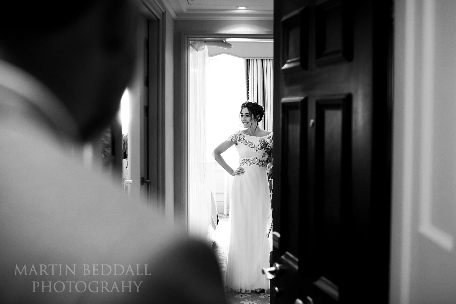 Bride show her wedding dress to her father