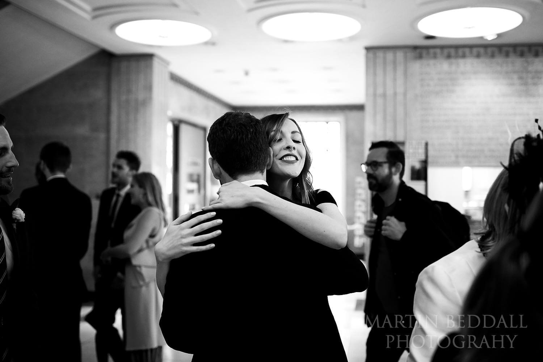 Guests greet the groom at RIBA