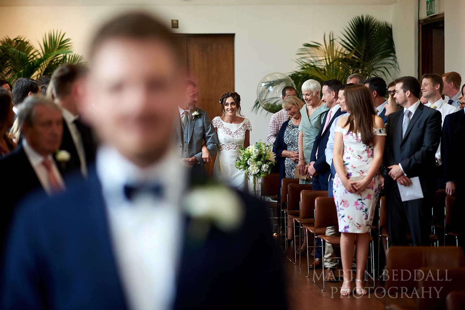 Bride walks down the aisle with her father at RIBA wedding