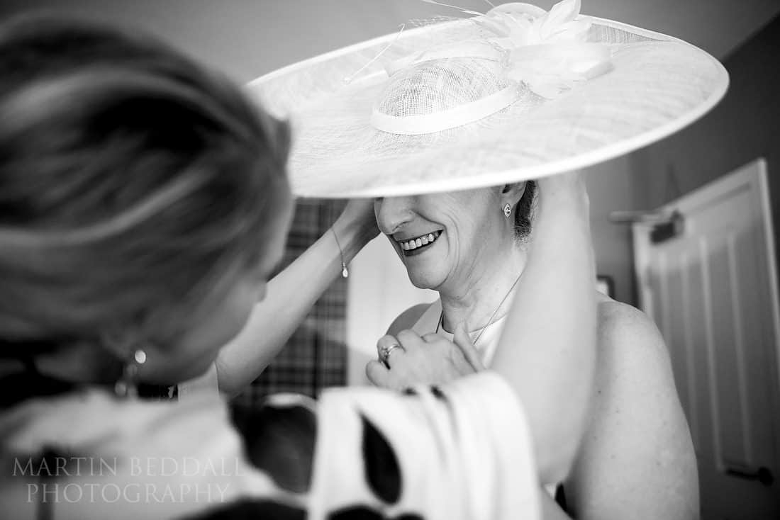bride's mother has help with her hat
