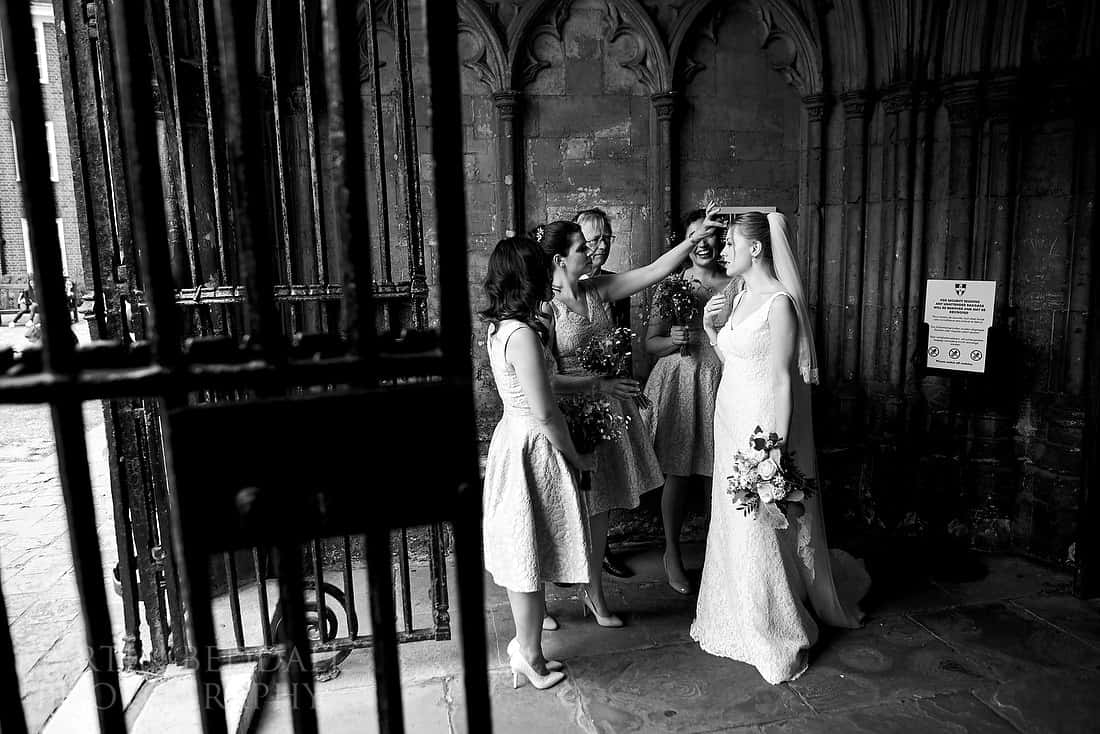 Bride waits in the cathedral porch