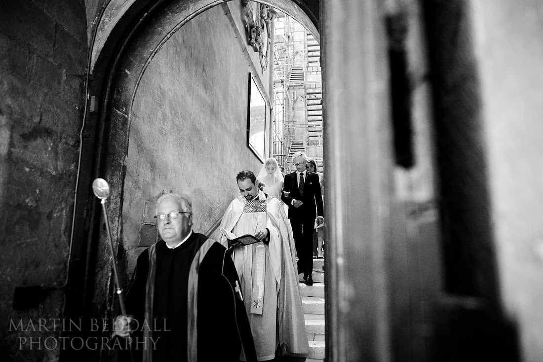 Bride walking down to the crypt with her father