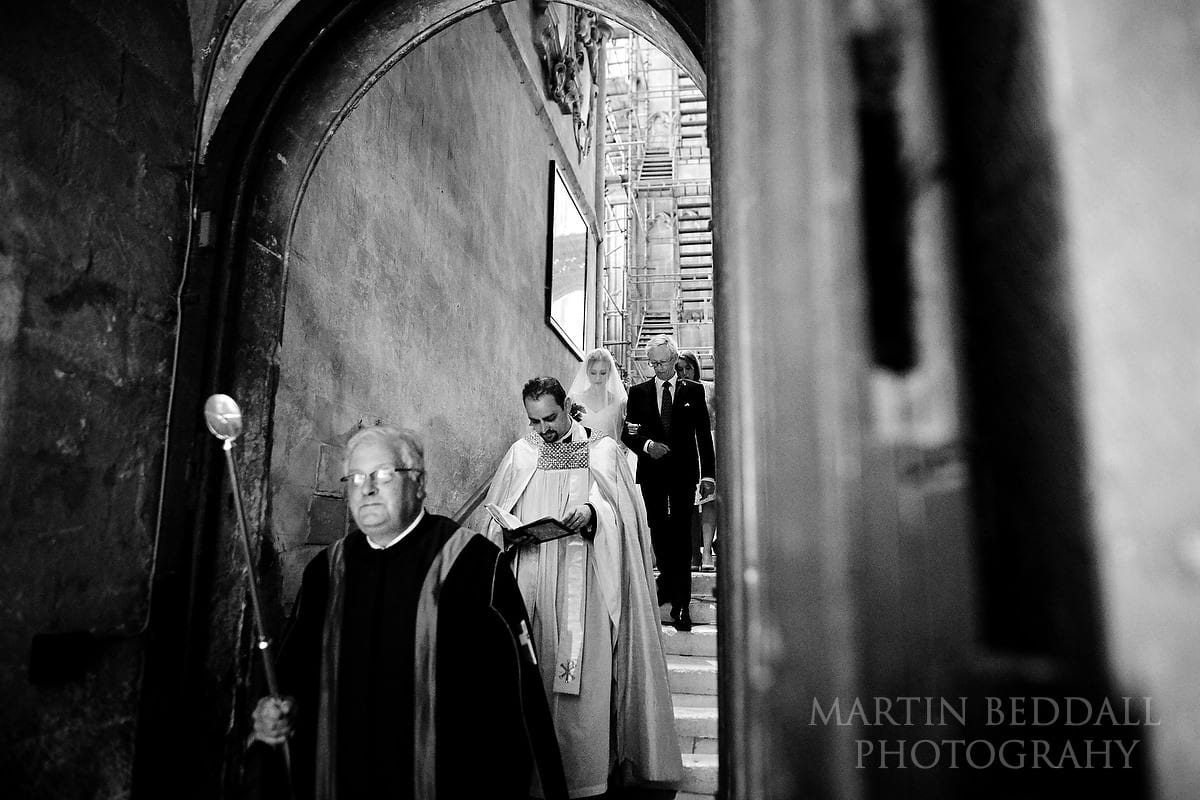 Bride escorted down to the crypt at Canterbury Cathedral