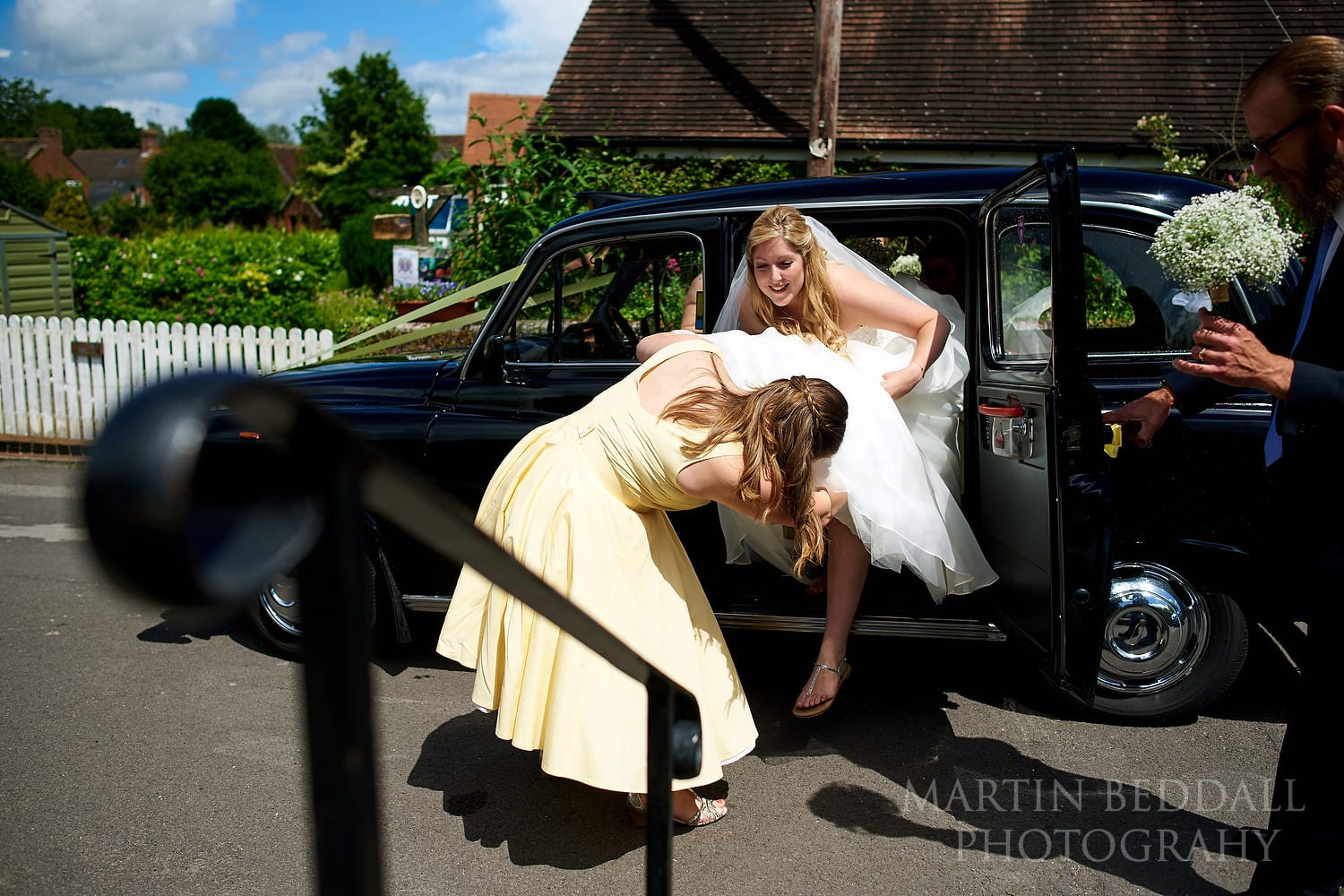 Bride arrives by black taxi cab