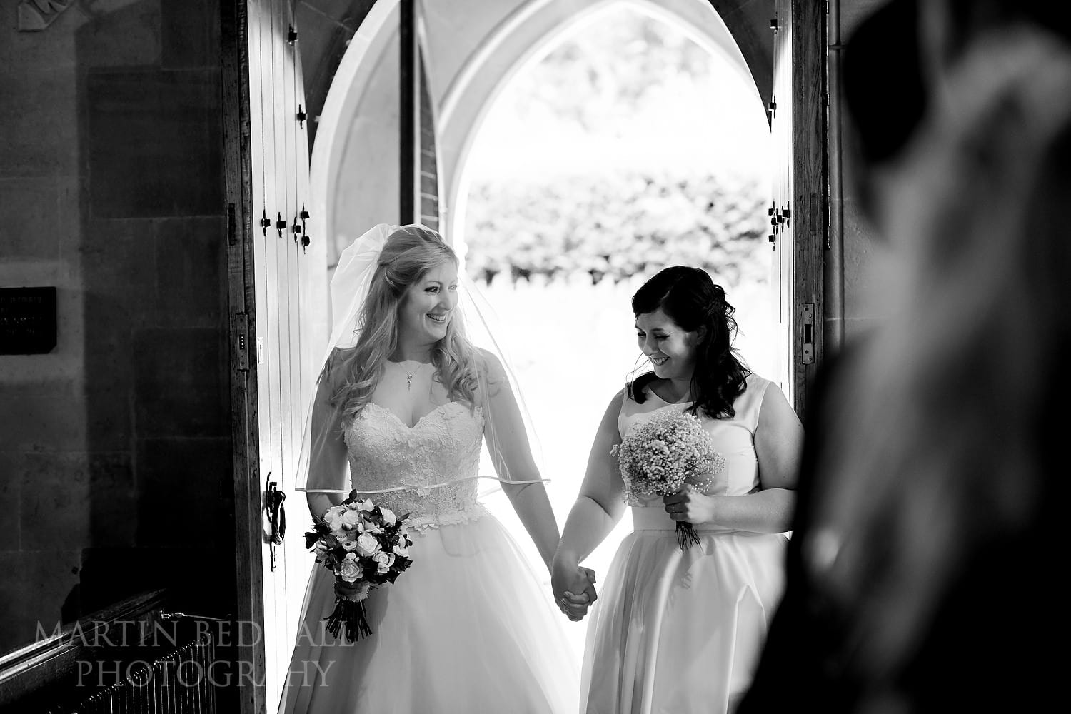 Bride walks into the church with her sister