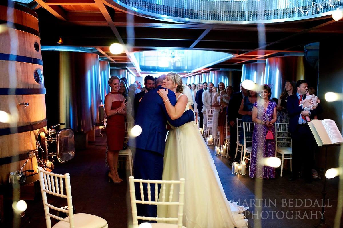 Bride and groom hug at Château Soutard wedding