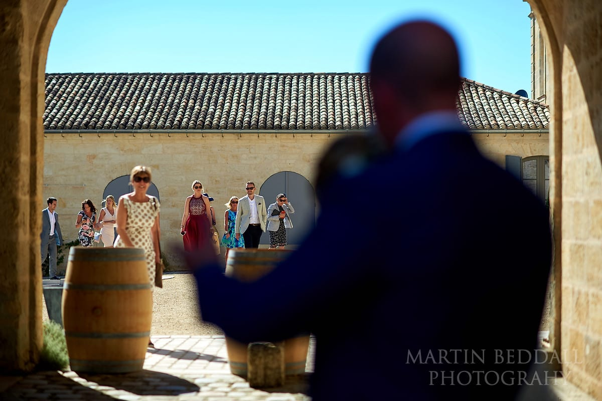 Wedding guests head to the drinks reception at Château Soutard