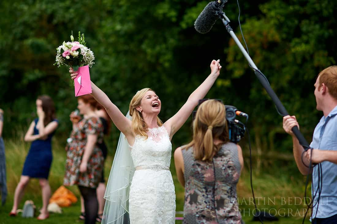 TV crew interview the bride
