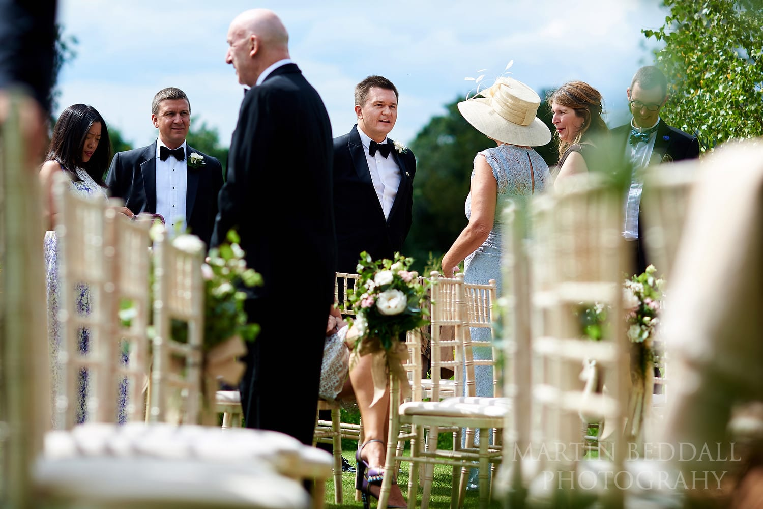 Groom greets arriving guests at Coworth Park wedding
