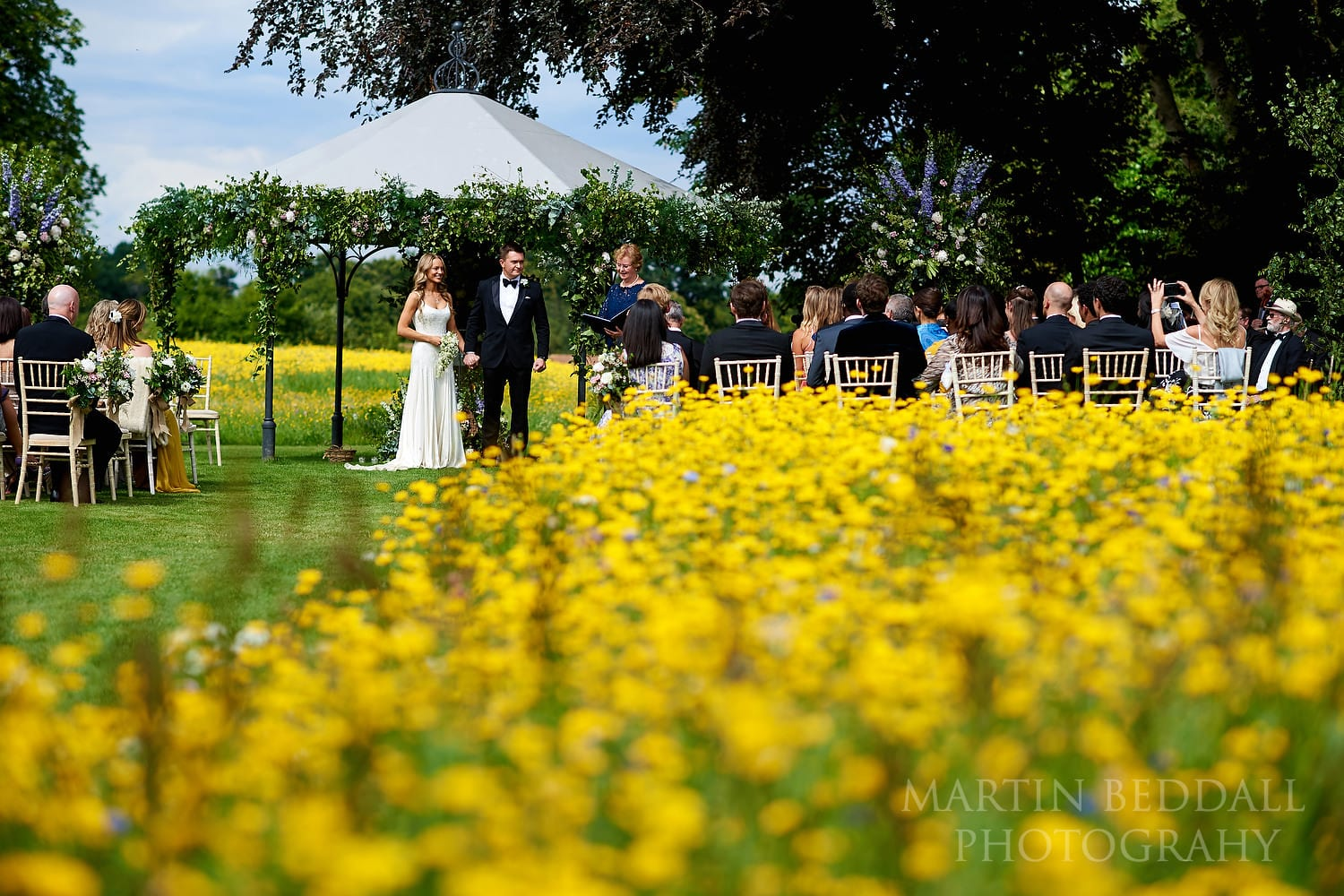 Outdoor wedding in the meadow at Coworth Park