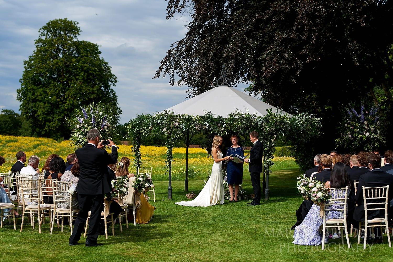 Wedding vows at Coworth Park wedding