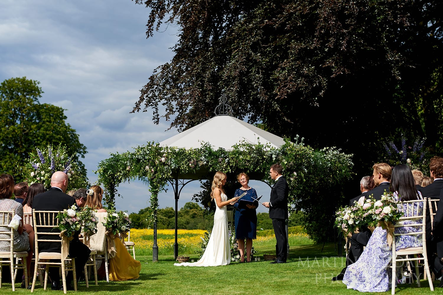 Coworth Park wedding ceremony in the meadow