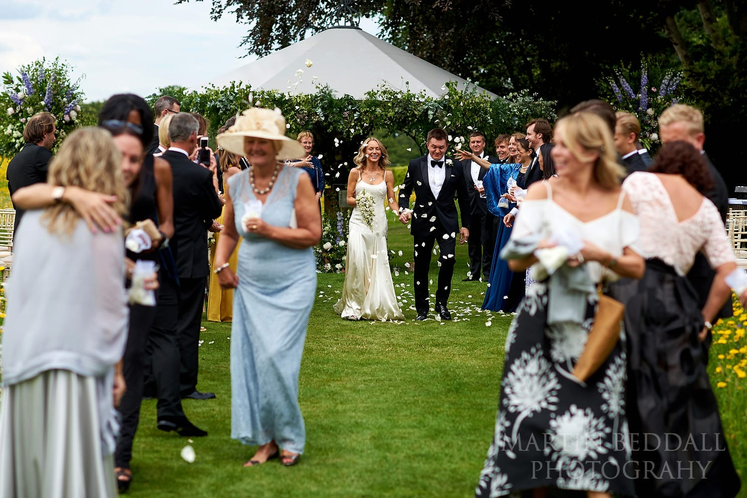 Confetti at outdoor wedding at Coworth Park