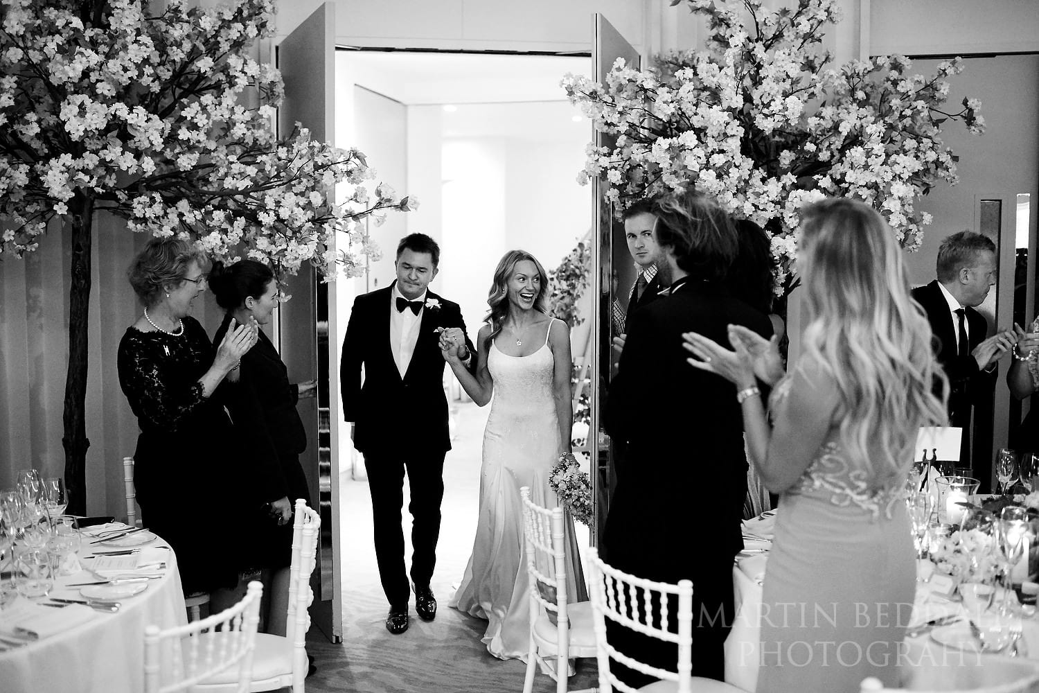 Bride and groom announced into dinner at Coworth Park wedding