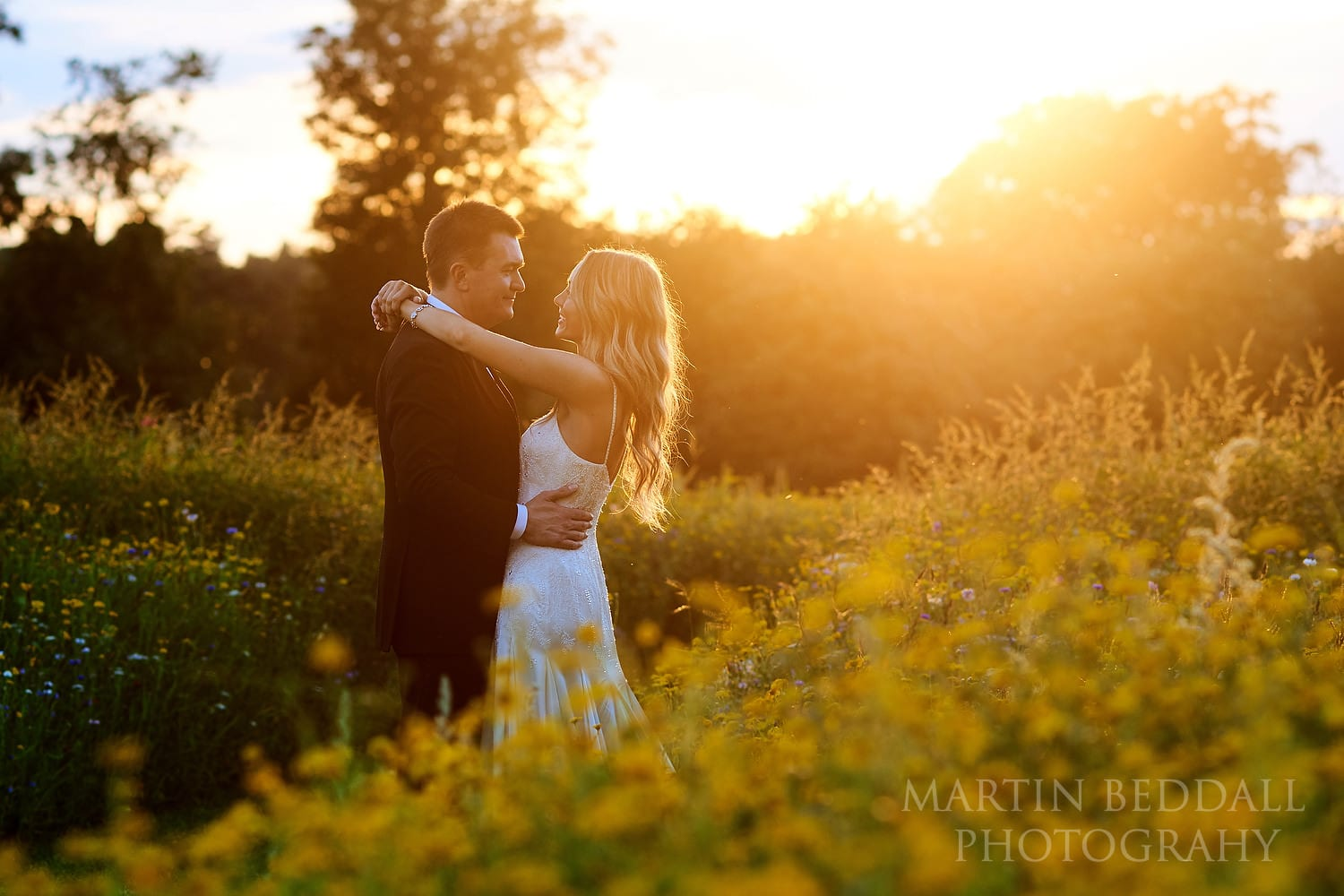Bride and groom at Coworth Park sunset