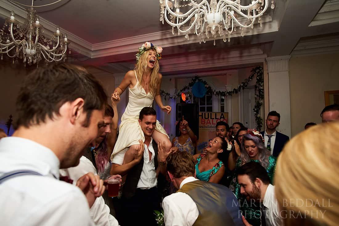Bride on a friend's shoulders