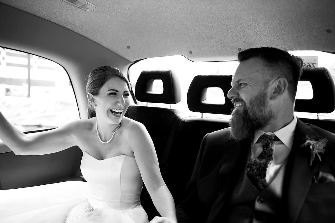 Bride and her father in the cab to the ceremony
