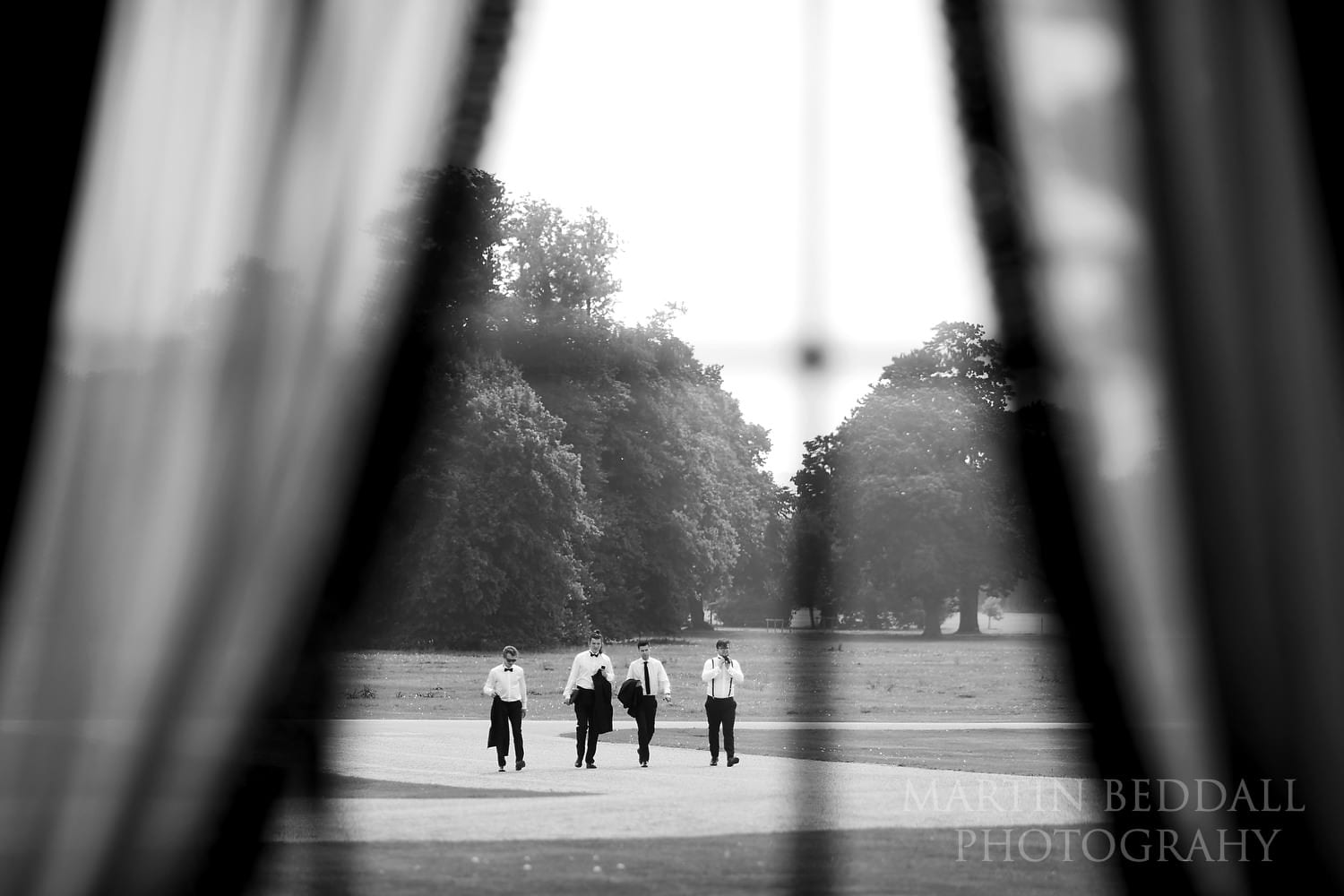Groom and his groomsmen walking to Goodwood House