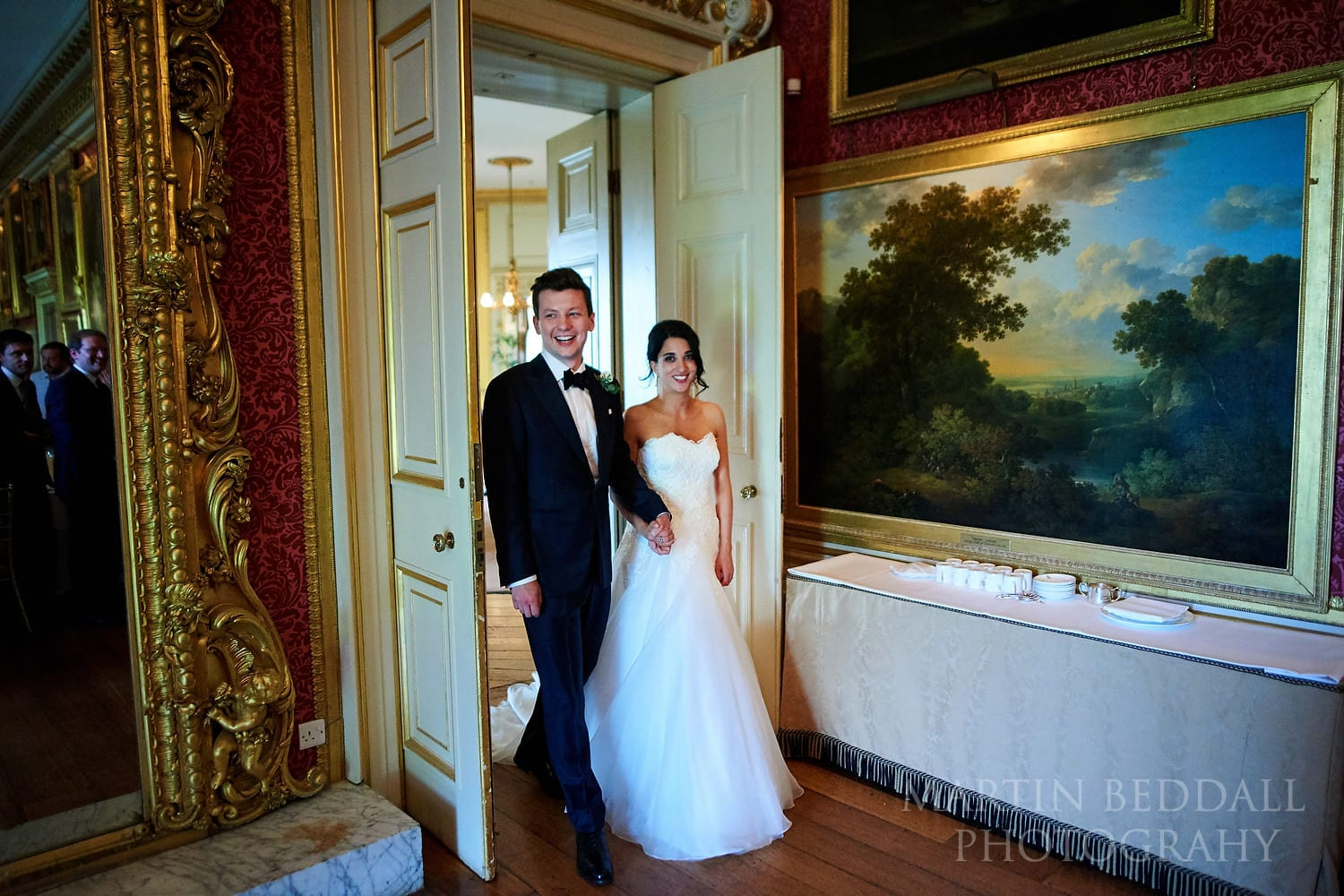 Bride and groom enter for the Goodwood House wedding dinner