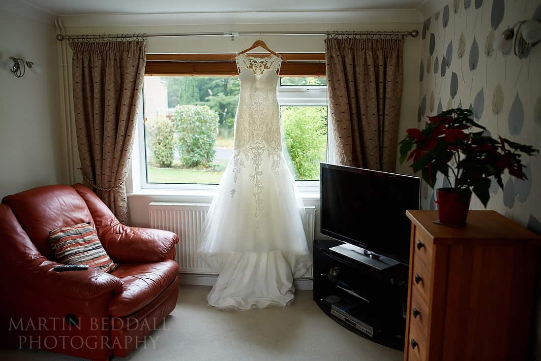 wedding dress hanging in the sitting room