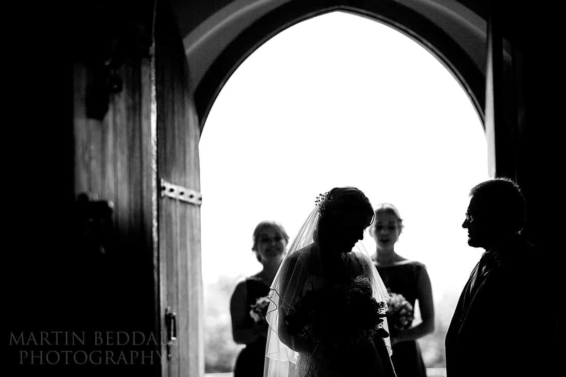 bride prepares to enter the church